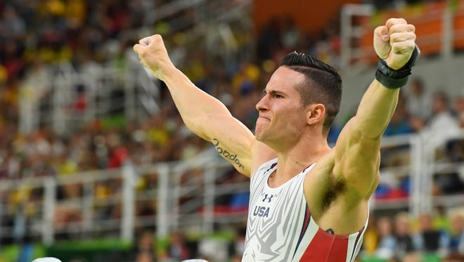Alex Naddour celebrates after completing the pommel horse finals on Aug 15, 2016 in Rio de Janeiro, Brazil.