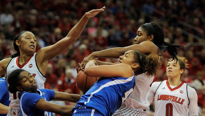 UofL's Myisha Hines-Allen (in back) battles Kentucky's Alyssa Rice (in front) and Taylor Murray (24) for a rebound on Sunday at the KFC Yum! Center. At left is Cortnee Walton and at right is Briahanna Jackson. Dec. 4, 2016