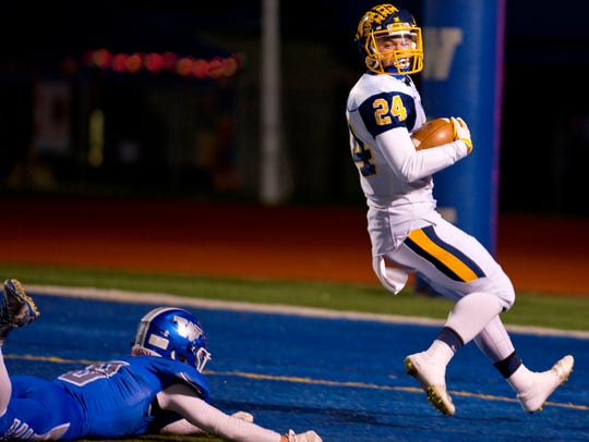 South Lyon's Will Kelley (right) finds the end zone