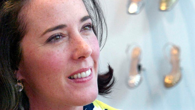 In this May 13, 2004, file photo, designer Kate Spade poses with shoes from her next collection in New York.