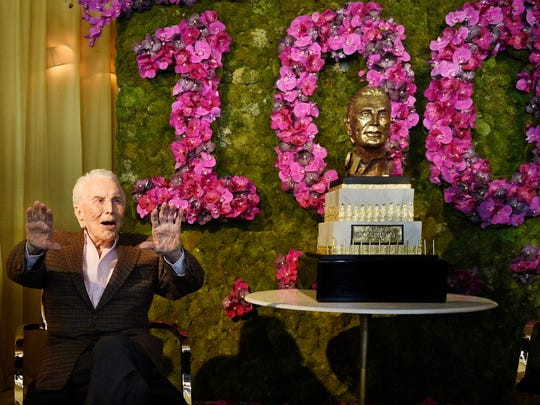 Actor Kirk Douglas acknowledges applause from the crowd at his 100th birthday party at the Beverly Hills Hotel on Friday, Dec. 9. 2016, in Beverly Hills, Calif.