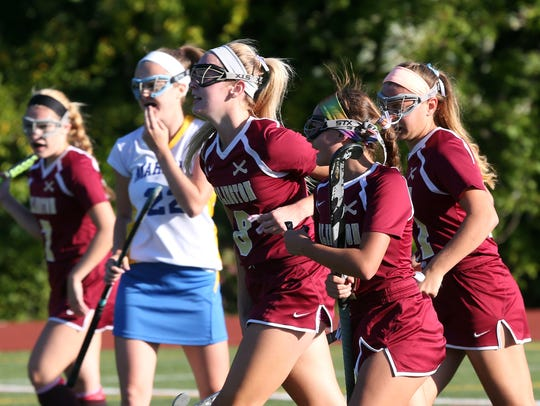Arlington players celebrate a first half goal during