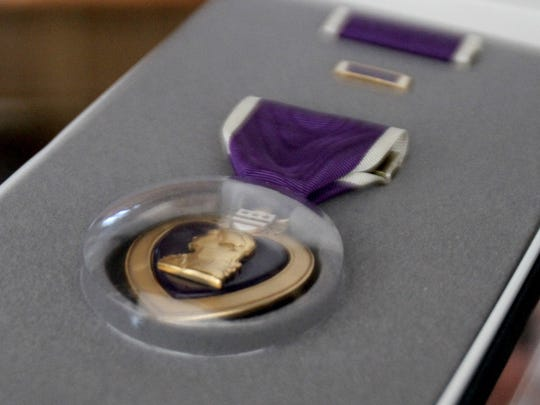 The Purple Heart that was awarded to Michael Ricci is displayed in his Manasquan home Thursday, March 16, 2017.   Ricci. the 72-year-old founder of Operation Beachhead, runs adaptive surfing and ice skating events for disabled vets and others with disabilities.