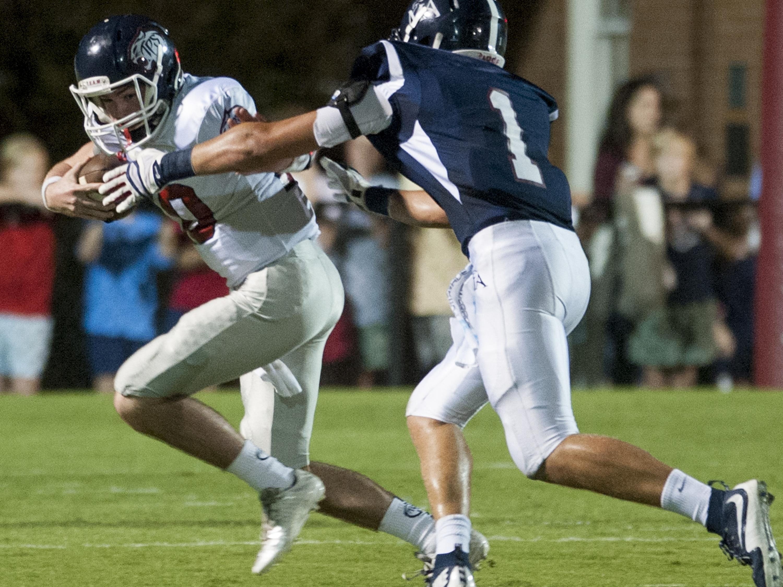 Montgomery Academy's Samuel Hudson sacks Trinity quarterback Charlie Trotman at MA's campus on Friday.