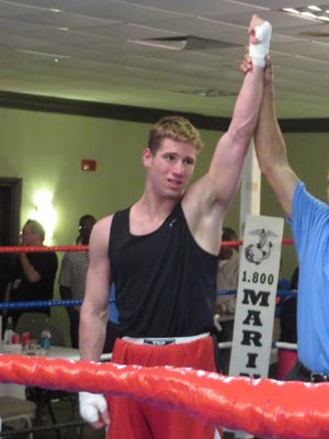 Matt Kligerman, who is shown here winning the 1,000th match in Ragin' Cajun Boxing Club history back in 2015, will be returning to town for the National Golden Gloves as the New York state champion.
