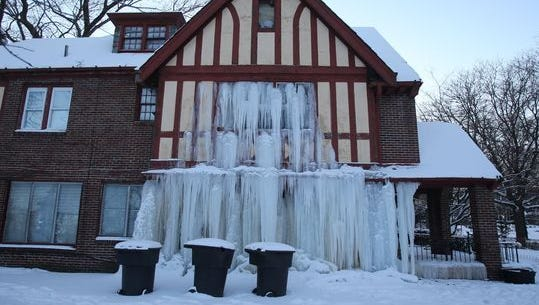 E. T. Williamson's home at West Boston and 14th Street in Detroit sits damaged after a water pipe burst, causing water to freeze inside and outside the home.