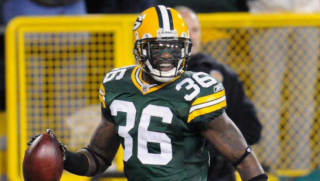 Green Bay Packers safety Nick Collins (36) is all smiles as he returns a fumble for a touchdown against the Dallas Cowboys in 2010.
