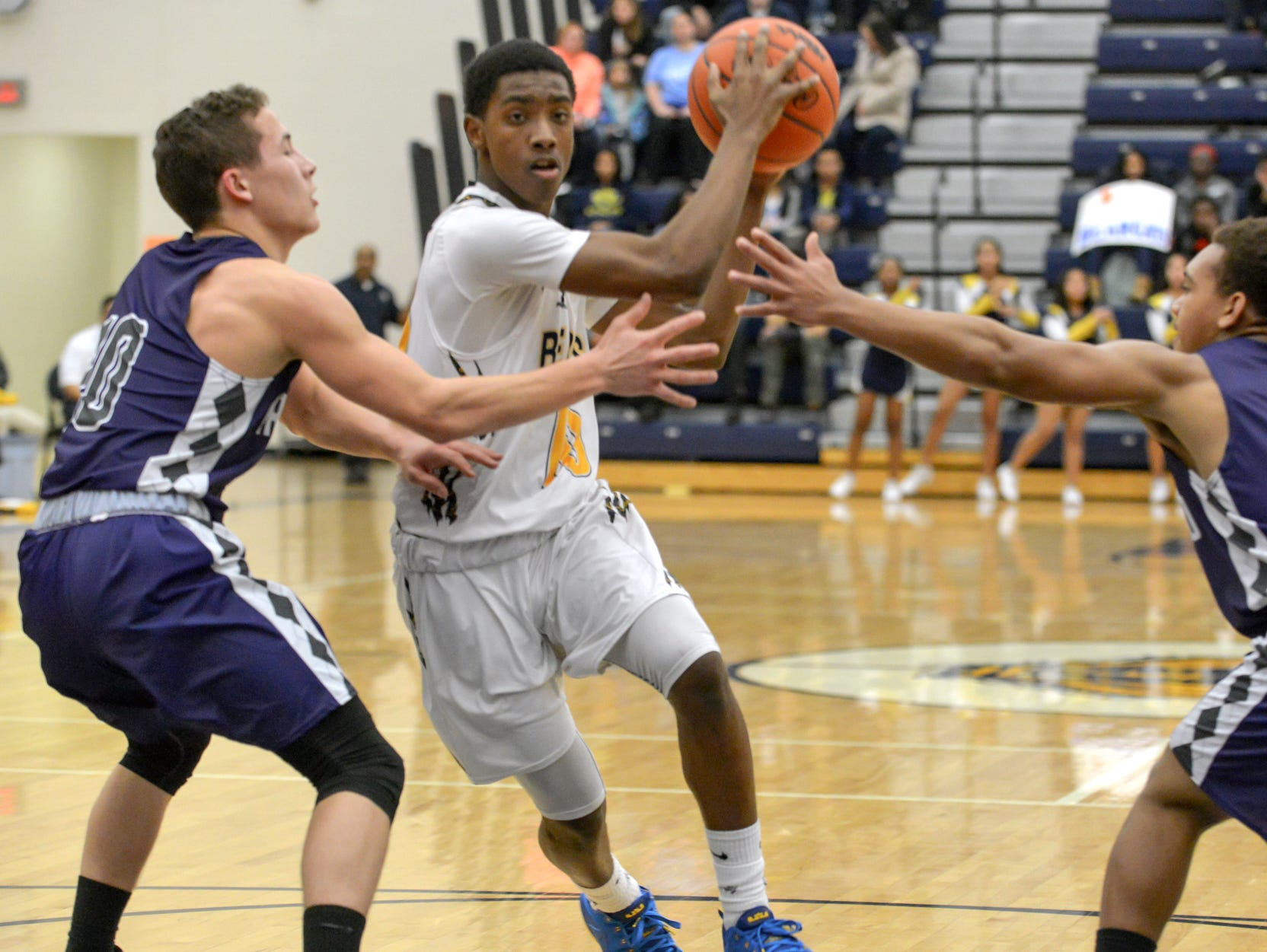 Central's Jahmiel Wade drives through two Lakeview defenders Thursday night.