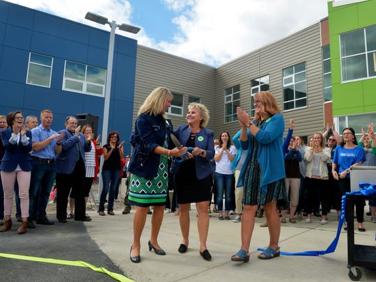 Great Falls Public Schools Superintendent Tammy Lacey, left, Assistant Superintendent Ruth Uecker, center, and Giant Springs Elementary School Principal Rhonda Zobrak cut the ceremonial ribbon for Giant Springs Elementary School, Tuesday afternoon ahead of the first day of school on Wednesday.