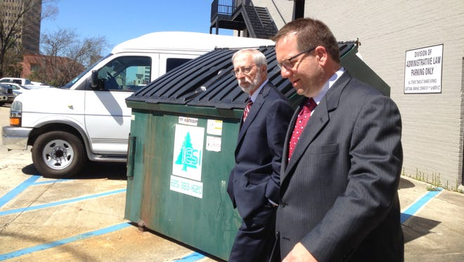 Greg Gachassin, right, leaves a hearing in 2014 on proposed ethics charges.