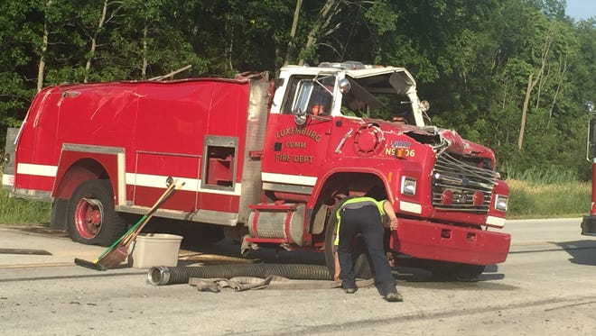 A Luxemburg firefighter was injured Wednesday in a rollover crash involving the fire truck he was driving.