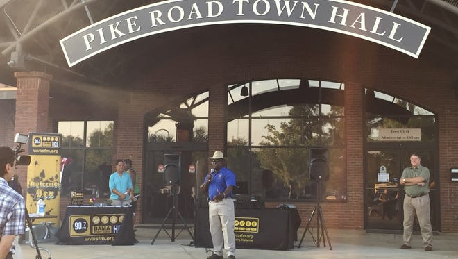 Montgomery County Sheriff Derrick Cunningham speaks during the 2015 National Night Out at the Town of Pike Road complex.  Town of Pike Road Town Council President Chris Dunn listens at right. This year's event is set for Aug. 2 at 6 p.m.