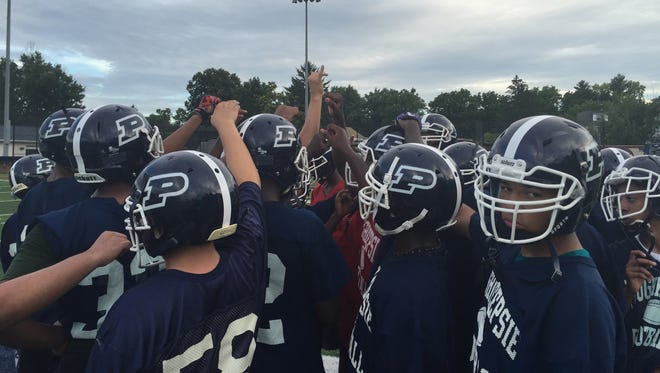 The Poughkeepsie High School football team huddles during practice. Aug. 15, 2016.