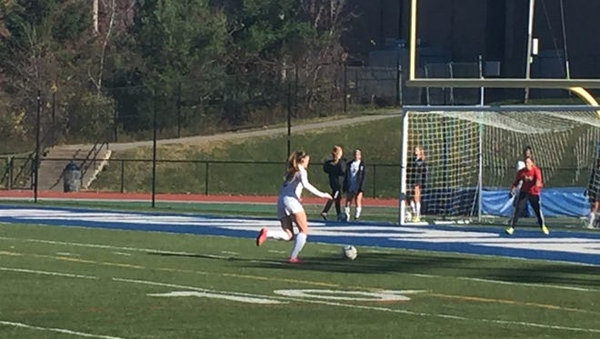 Gabrielle Prichard warms up before the Spackenkill High School girls soccer team's regional final against Chenango Forks on Friday.