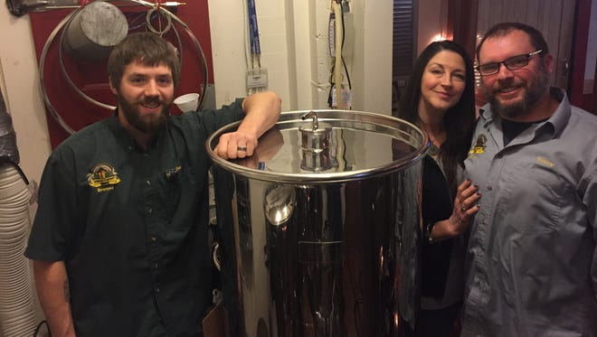 Kristi Streamer, middle, and husband, Tommy Streamer, right, own Warsaw's Amber Lantern Brewing Co. Brewer Ben Bernard is on the left.