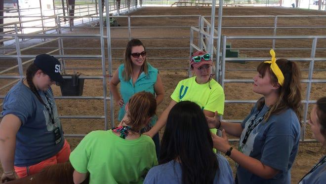 Volunteers with Student Life Ministries visit with Sonrisas Program Director Megan Kirkwood on Thursday, June 22, 2017, in San Angelo.