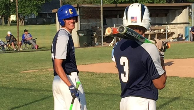 Sandusky American Legion's Robbie Webb shares a laugh with Nathan Delk.