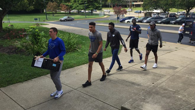 Kentucky basketball players deliver packed lunches at Picadome Elementary School in Lexington, Kentucky on Friday, September 15, 2017.