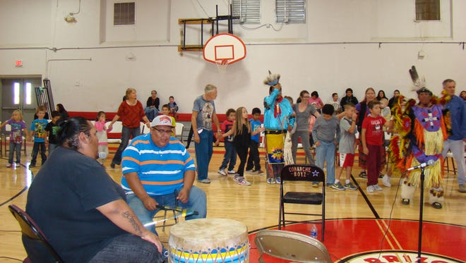 Brothers Brady and Brad, members of the Comanche Boyz are shown at the drum during an Intertribal dance at the Carrizozo Schools gymnasium. The first nation drum and dance exhibition, sponsored by Carrizozo Music Inc., was presented in the afternoon and again in the evening.