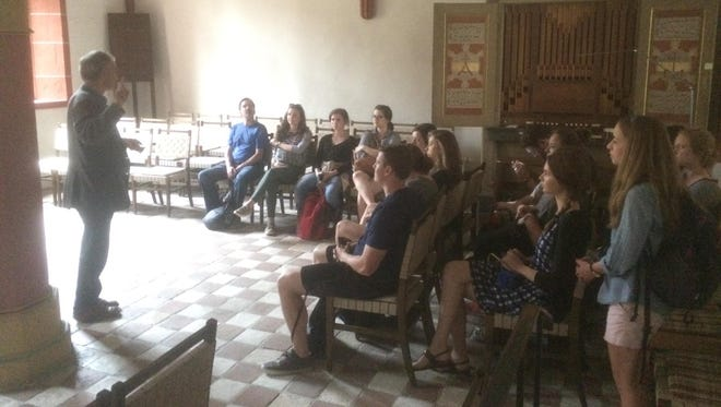 Anderson University students on study abroad program visited the Augustinian monastery in Eufurt, Germany, where Martin Luther spent time as a monk, confessing his sins.