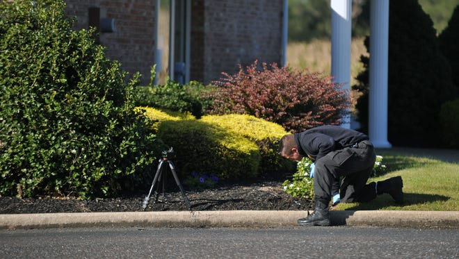 Crime scene investigators from New Jersey State Police respond to a reported robbery at Cape Bank on Rt. 77 in Upper Deerfield Tuesday, Oct. 11, 2016.
