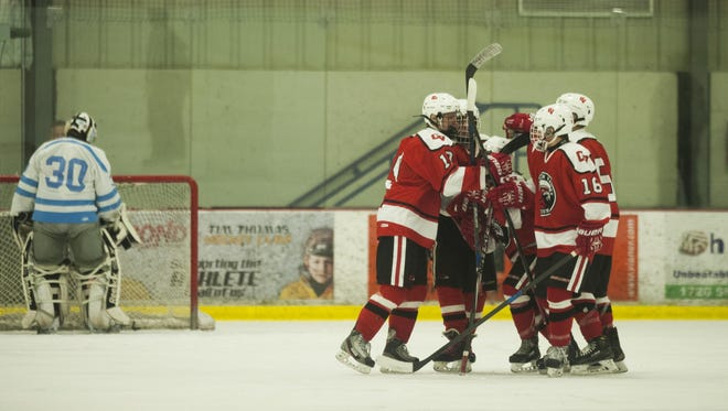 CVU celebrates a goal during the boys hockey game against South Burlington at Cairns Arena on Wednesday night Feb. 3, 2016 in South Burlington.