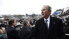 Former US President George W. Bush leaves after the