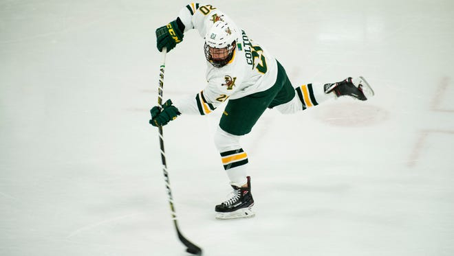 Vermont forward Ross Colton (20) takes a shot during the men's hockey game between the Boston College Eagles and the Vermont Catamounts at Gutterson Field House on Friday night November 10, 2017 in Burlington.