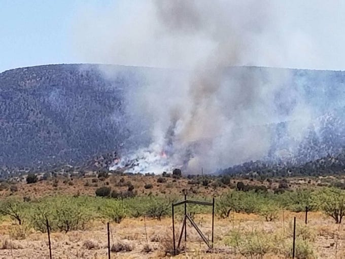 A brush fire burning south of Camp Verde closed Interstate