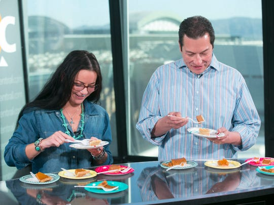 Azcentral digital producer Chelsey Heath and Republic/ azcentral reporter Richard Ruelas, taste test five different store bought pumpkin pies in the azcentral studios in Phoenix on November 2, 2016.