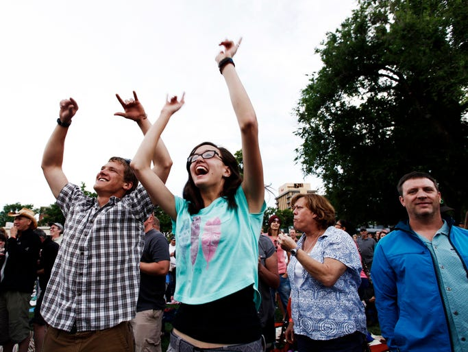 Lucas Gintner and Carmen Soller enjoy dancing to Collective Soul at the Taste of Fort Collins Saturday June 14, 2014.