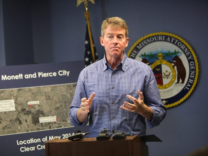Attorney General Chris Koster announces that he is suing Tyson Foods over a May fish kill near Monett on Tuesday, June 17, 2014.