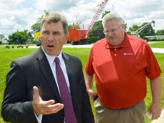 "Department of Community and Economic Development Secretary Dennis Davin, left, chats after a tour of Manitowoc Cranes, Shady Grove, onn Wednesday, July 26, 2017 as part of Governor Tom Wolf's ""Jobs the Pay"" tour. Les Middleton, senior vice president Americas-mobile cranes, is pictured at right."