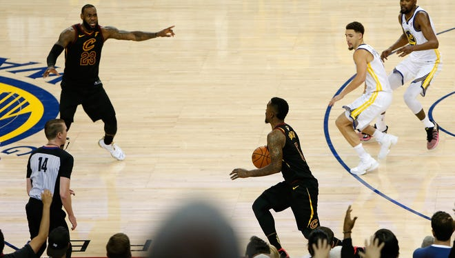 J.R. Smith dribbles in the closing seconds of regulation.
