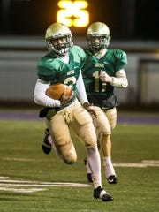 The graduation of all-state running back Jakkar Kinard (2) and all-state quarterback Dan Yokemick (11) have created holes in the Fighting Irish offense and defense that will make it difficult to repeat as Division III champions.