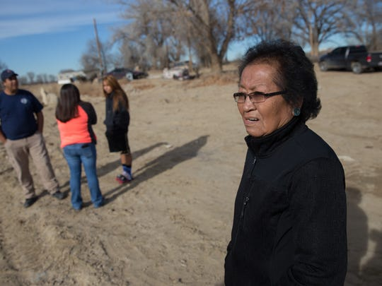 Alice Shorty looks over the area where her house once stood Wednesday in Shiprock. Shorty lost her home during the Aug. 5 Salt Creek Wash flash flood.