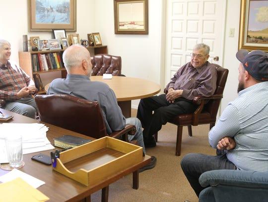John Alexander, left, Kurt Fagrelius, Tom Dugan and Sean Dugan talk about the Dugan Production Corp. at their office in Farmington earlier this year.