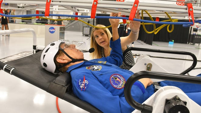 Retired astronaut Sam Durrance trying the spacewalk training with Dawn Morrison, education operations manager. A preview of the new Astronaut Training Experience Center and Mars Base 1 at Kennedy Space Center Visitor Complex. Three retired astronauts were on hand to work with guests. The new attraction, scheduled to open in February of 2018, is currently available for limited previews, and features immersion simulation technology to simulate a mission to Mars.