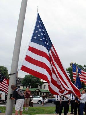 Flag raising.  Flag raised by members of American Legion Post 53 (Photo by Marion Brown)