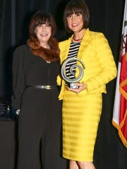 Susan Stein presents fashion icon Trina Turk with her award.