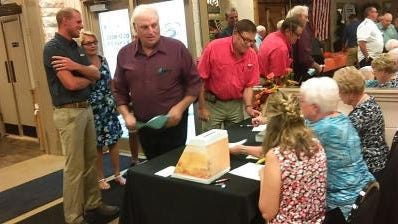 Visitors arrive to the annual dinner-meeting of the Monroe County Farm Bureau held in the past at the Old Mill Banquet Hall in Dundee. This year, a drive-in format will be used at the 2020 meeting planned Sept. 17 at the Monroe County Fairgrounds.
