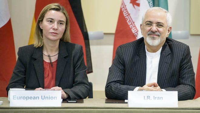 Iranian Foreign Minister Javad Zarif, right, and European Union High Representative Federica Mogherini wait for the start of the talks.