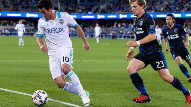 Sounders midfielder Nicolas Lodeiro (left) gets possession of the ball against San Jose midfielder Florian Jungwirth during the first half Saturday at Avaya Stadium.