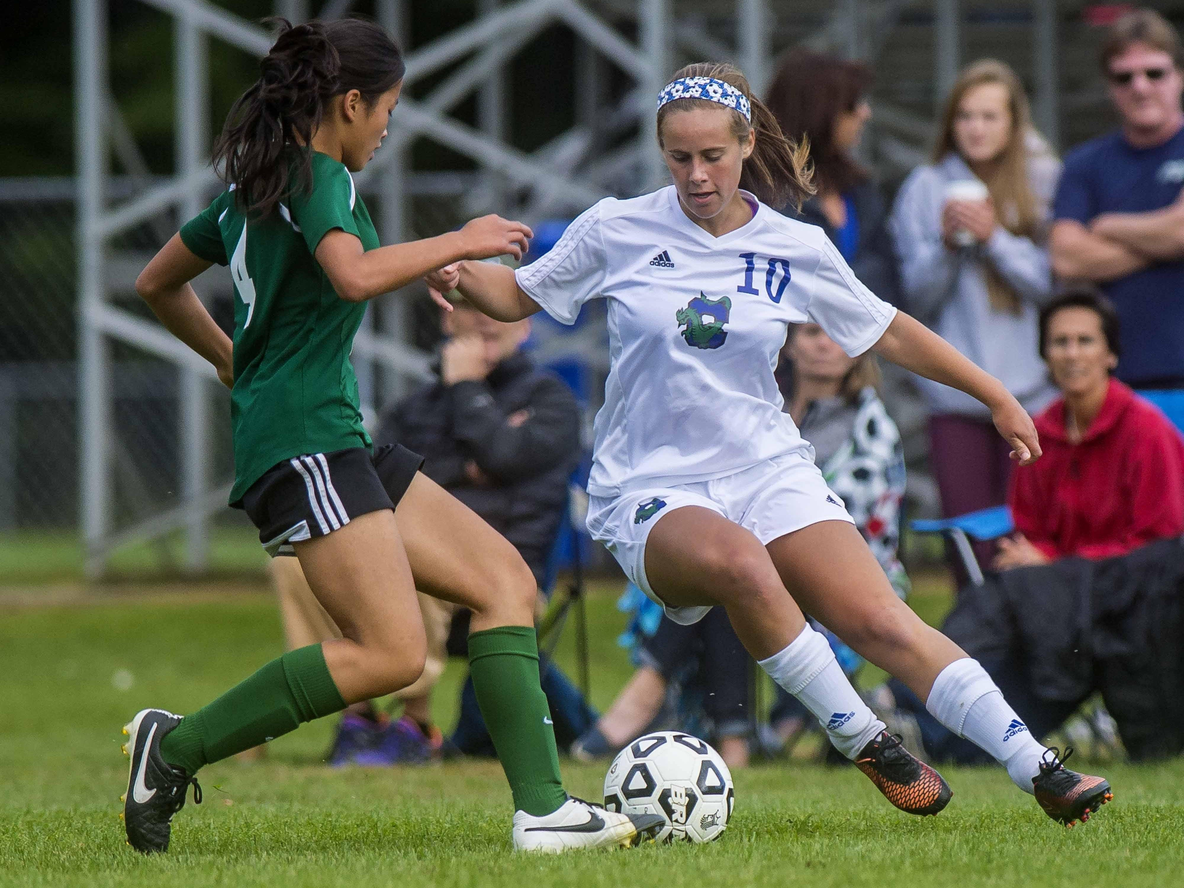 Colchester's Katie White, right, tries to get the ball past St. Johnsbury's Jen Rotti in Colchester on Friday, September 25, 2015.