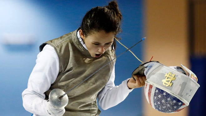 Lee Kiefer of the United States celebrates beating Saskia Loretta Van Erven Garcia of Colombia in the women's fencing individual foil gold medal final during the 2015 Pan Am Games at Pan Am Aquatics UTS Centre and Field House in Toronto on July 22, 2015.