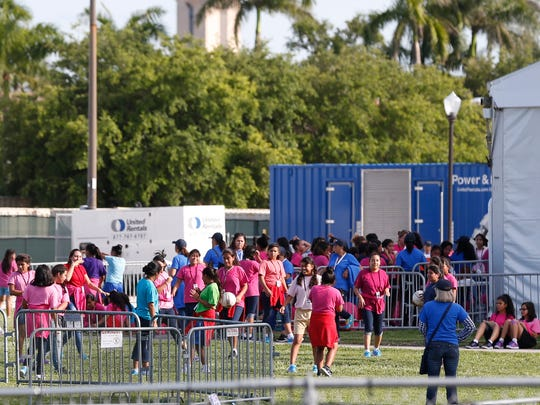 Immigrant children play outside a former Job Corps site that now houses them June 18, 2018, in Homestead, Florida.