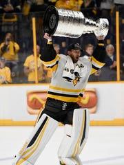 Pittsburgh Penguins goalie Matt Murray (30) hoists