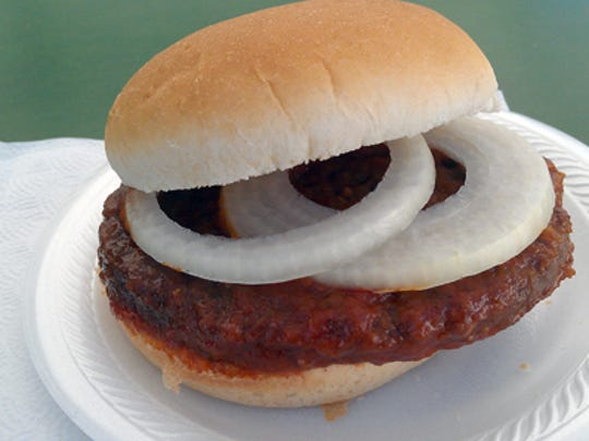 A Bury's burger - a hamburger boiled in tomato sauce and topped with a sweet onion.