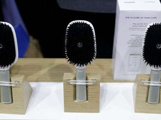 Hair Coach smart hairbrushes are displayed at the Withings booth during CES Unveiled before CES International, Tuesday, Jan. 3, 2017, in Las Vegas. The brush uses sensors to track hair damage and will, via a smart-phone app, offer recommendations and advice on hair care.