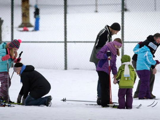 Festival goers prepare to try their hand at skiing